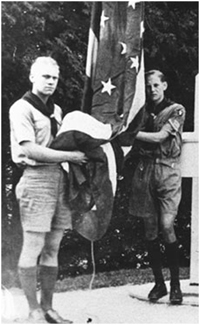 Gerald Ford (left) assists in raising the Fort Mackinac flag in 192
